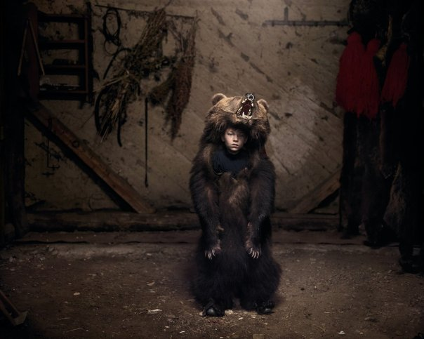 on-new-years-day-in-romania-young-children-dress-in-bear-furs-and-dance-to-ward-off-evil-spirits